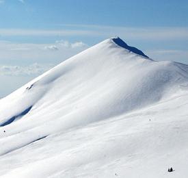 Връх Ком - снежното очарование на Балкана